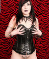 Hot tattooed Gothic dominatrix