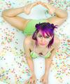 Cute Bikini Raver Babe in Pool of Fruitloops